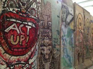 Graffiti adorns a piece of the Berlin Wall.