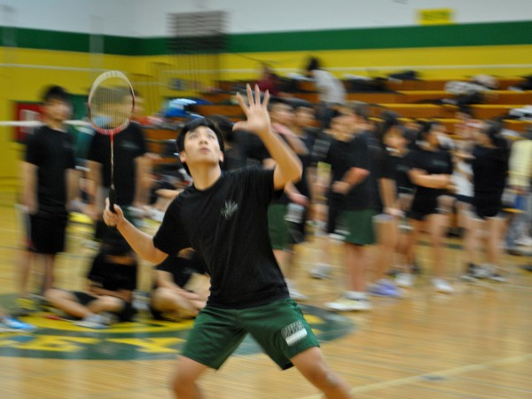 Daniel Chen follows the bird with his eyes and prepares to swing.