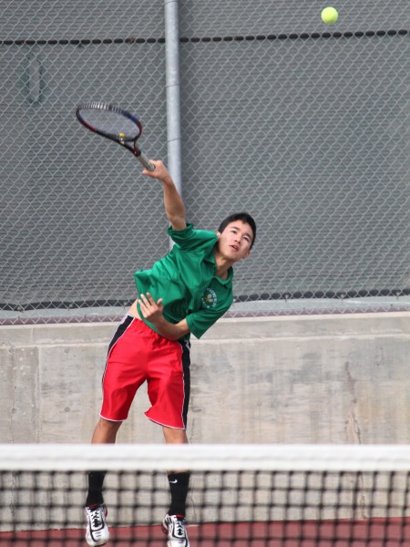 Junior Jesse Pawid serves the ball over the net to his opponent.
