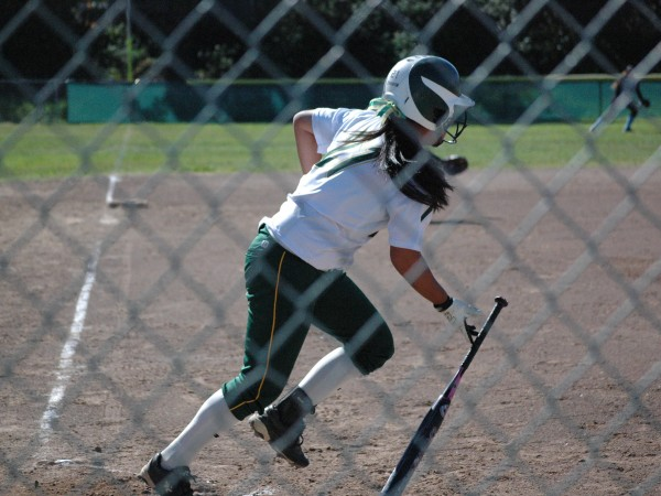 Freshman Leilani Huey drops her bat to sprint for first base.