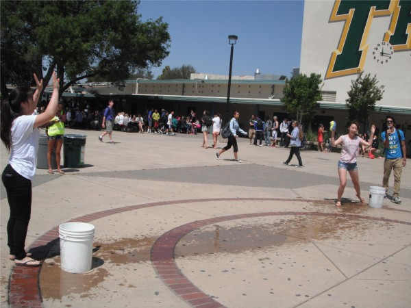 Students participate in a water bucket game to learn the dangers of tobacco.