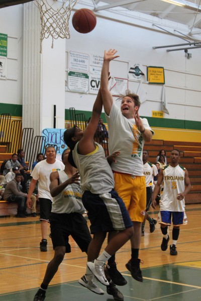 English teacher Josh Linville takes a shot as student tries to block his attempt.