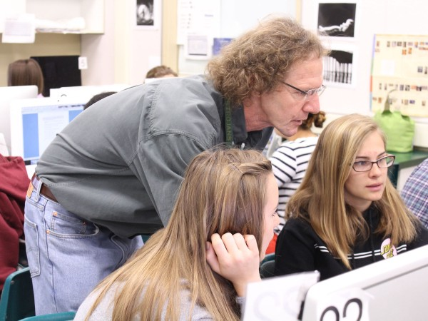 Photography teacher Jeff Vendsel assists students in creating the new yearbook. Photo by Michael Castillo