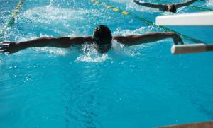 Erik Clemensen flies through the water during the swim meet. Picture by Robbie Brandt