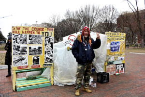 Students met a determined protestor outside the White House fence. Photo by Maia Samboy.