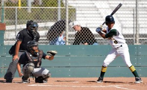Christian Merriweather prepares to swing during an intense game. Photo by Jes Smith.
