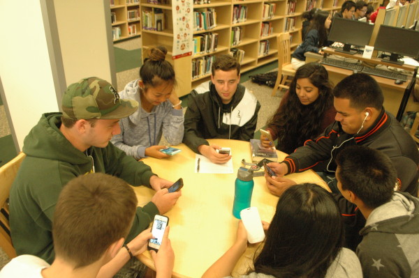 Students play on their phones while other students slave during the SBAC. Photo by Laniah Lewis.