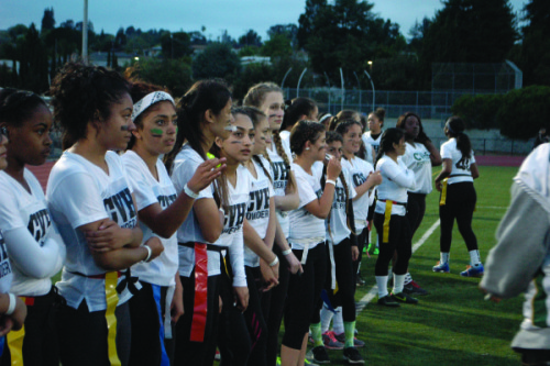 The sophomore and senior team listen carefully before the game begins. Photo by Maia Samboy.
