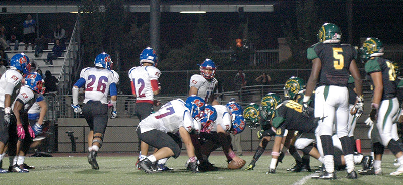 Trojans take a tough loss against Pirates during homecoming game