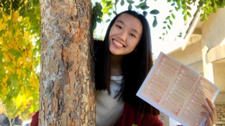 Senior member Sophia Siopack shows off her Red Cross November Hunt checklist.