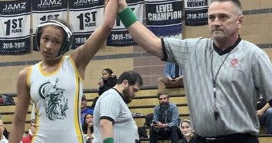 Zaballos balances wrestling, coaching, work and school